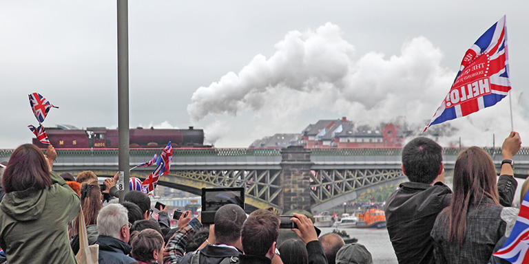 Celebrating Jubilee by the thames. Royal train passing.